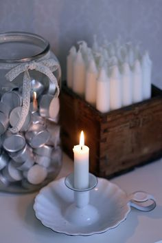 Box to displsy candles and jar to store tea lights. Pretty and practical.