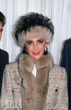 Elizabeth Taylor wearing fur-trimmed coat and head muff