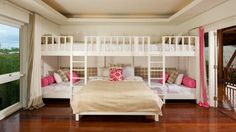 What a great family bedroom!  Perfect for a bunkhouse or large guest room!