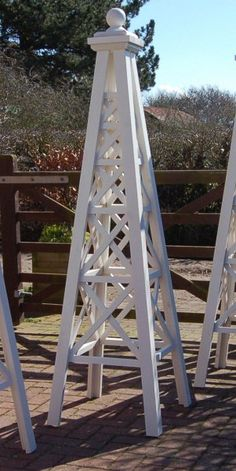 Garden Obelisks -The Steeple Obelisk is an elegant, decorative plant support, in filled with cross timbers, and topped with a Ball finial. Garden Yard Ideas, Garden Spaces, Garden Projects, Obelisk Trellis, Garden Trellis, Wooden Garden Planters, Garden Structures, Pergola Plans, Chickens Backyard