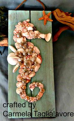 Sea shell sea horse on board for beach home wall decor
