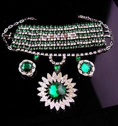 """This glamorous group of IRISH green jewelry is over the top., The bracelet is HUGE ( 2"""" wide x &"""" long) with 206 rhinestones. The chandelier necklace will go up to 14"""" long. The clip"""