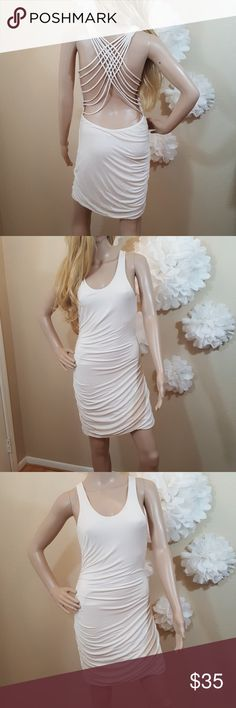 """Cotton Backless Mini Dress In great condition.. Please see all photos for wear.. No rips holes or stains.. 36"""" long.. 24"""" bust and waist.. elastin/cotton blend.. the side tag has been cut.. All items are clean.. Shipping next business day..  I have sold over 100 listings and counting.. Click on the About tab in my closet.. and read my perfect five star posher reviews ... I list with the greatest of integrity, allowing you to shop my closet with confidence.. Lush Dresses Mini"""