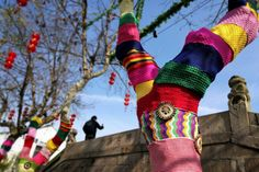 Bare trees put on colorful sweaters to welcome the Chinese New Year  Numerous bare trees in Wuxi, east China's Jiangsu Province have been dressed up in polychrome sweaters, adding color to the previously mundane winter streetscape.  Helping the trees to keep warm so as to fend off the invading cold air, which has led to a sudden temperature plunge in the city, the colorful sweaters made with abandoned clothes and woolen yarns by local citizens are also expected to boost the festive…