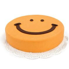 smiley Cake  Price:  €28.65  Make everybody happy with this cheery Smiley Cake delivered at home or at work A delicious cake filled with delicious cake and a creamy raspberry filling! 12 persons, ordered today, delivered tomorrow!