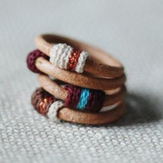 Set of four leather and cotton rings by kjoo on Etsy, $50.00