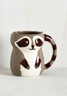 There's nothing quite like coffee shared with friends, so spread the love by pouring a cup in this super cute ceramic mug! Featuring a rapturous raccoon design, this darling, dishwasher safe piece is the greatest creature comfort of all.