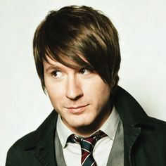 Adam Young, of Owl city.  I love the lyrics to his songs.  They make me smile and want me to keep writing.