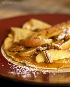 Delicious crepes filled with cheddar cheese and topped with sauteed apples, toasted pecans and maple syrup