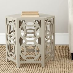@Overstock - What's good is good. Embrace circular logic with the Natanya side table.  This chic accent piece adds contemporary charm with interlocking circles and the clean lines of its hexagonal tabletop. Perfect for classic interiors.http://www.overstock.com/Home-Garden/Safavieh-Natanya-Pearl-Taupe-Side-Table/7827761/product.html?CID=214117 $159.29