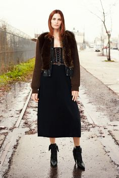 Givenchy - Pre-Fall 2015   Chocolate Marmot Outerwear with Knit Sleeves, Chocolate Flipper Printed Cady Jacket, Black Stretch Cady Skirt with Knit Border, 2cm Belt in Studded Leather, Black Calf Leather Laceup Boot with Black Lacquered Studs