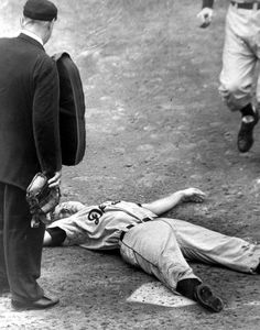 Comiskey Park, Chicago, Sept. 25, 1958 - Al Kaline is knocked out cold from a Bob Shaw pitch in the 6th inning during the Tigers 7-1 win over the White Sox. Kaline was hit in the back of the head and if it wasn't for his batting helmet, the injury could have bee worse. The 23-year-old RF would have to be carried off on a stretcher and taken to the hospital for x-rays, which came back negative. Despite the scare and the season coming to a close, Kaline would miss one game and return on Sept…