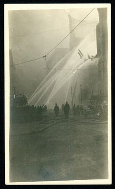 Firemen fighting the Missouri Athletic Club/Boatmen's Bank fire of 9 March 1914.