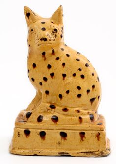 Lovely slipware cat, early to mid 19th century. Height 20cm.