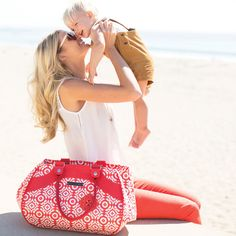 Such a cute photo of mom and son! Love her bright pants and bag, too!