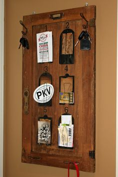 Love this idea...refurbish an old cabinet door by making it a memo-style board.  Super cute (and her blog is pretty creative...might have to follow!).