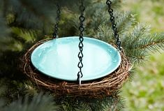Place a shallow dish in an old grapevine wreath, hang, and fill with water for an easy DIY birdbath. via Home Made Simple