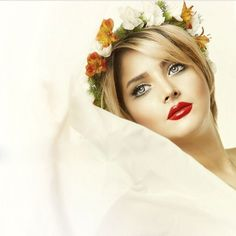 Beautiful Persian bride with blonde hair and nice makeup and flower crown.
