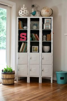 set of lockers from Craigslist, took off a few rows of the top doors to make open shelves, and spray painted the outside glossy white.