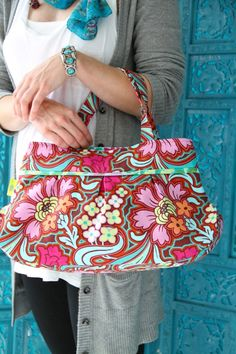 I have this bag.  Amy Butler's Soul Blossoms Fabrics with The Charm Clutch