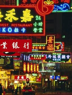 Photographic Print: Illuminated Neon Street Signs, Nathan Road in Tsimshatsui, Hong Kong by Gavin Hellier : 24x18in