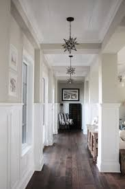 Image result for black floor to ceiling wood posts