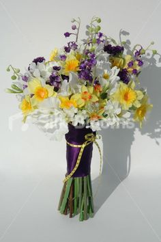 Gorgeous and it has my wedding flowers (daffodils) and wedding colors!!! (purple and green) purple and daffodil wedding bouquet -