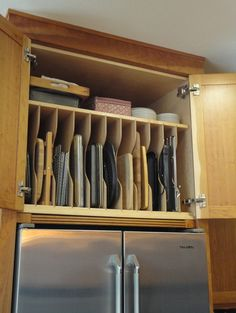 Slotted above-the-fridge storage is ideal for cutting boards, cookie sheets and cooling racks.