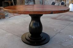 """ROUND COPPER DINING TABLE:54"""" diameter, round copper table top; alder wood pedestal base."""