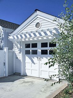 Love the trellis over the garage and the garage doors.