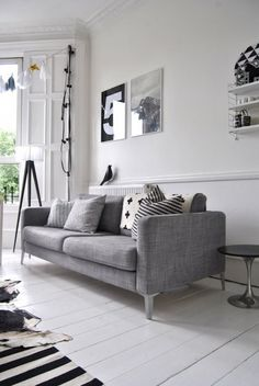 Keeping a limited colour palette like this grey, black and white room looks understated and chic