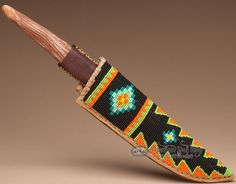 This is an authentic Native American rawhide knife sheath with hand beadwork as well as a handmade antler handled metal knife. Made according to Lakota tradition, this sheath is very unique. All stitc