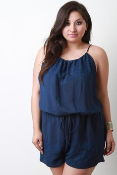 405944ae643 This alluring plus size romper features a scoop neckline with an adjustable  drawstring closure at nape