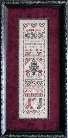 Christmas Cross Stitch.  @Larson-Juhl frame and matching fillet.  Framed by Frameworks of Utah. #crossstitch #customframing