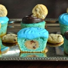 Cookie Dough Monster Cupcakes - Moist and fluffy cupcakes with a surprise filling and two frosting recipes! Ridiculously delicious.
