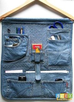 "These are ""recycled jeans"", but I bet I could make an AWESOME hanging toiletry bag like this. I want one that has more pockets and doesn't dump my stuff on the floor..."