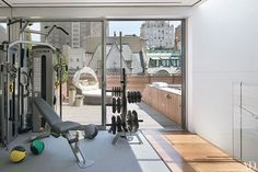 The gym and roof deck; the outdoor lounge is by Gloster.