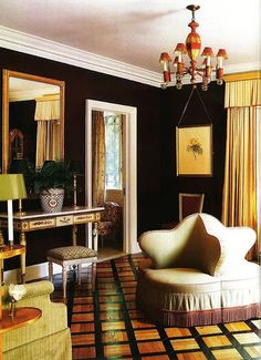 Black and gold sitting room - love that divided tete a tete chair