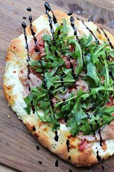 Trader Joe's. Weeknight Easy, homemade, delicious pizza crust topped with prosciutto, arugula and burrata, finished with a balsamic glaze. Burrata Pizza, Ricotta Pizza, Burrata Salad, Burrata Cheese, Pizza Gourmet, Gourmet Foods, Pizza Facil, Comida Pizza, Vegetarian Food