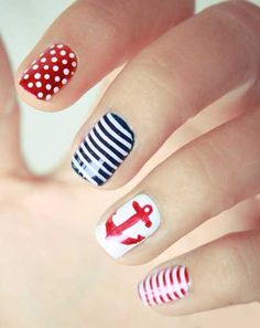 Love the sailor inspired look! Creative nail designs for your paws and claws.
