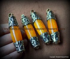 Handcrafted Nepalese Rich Egg Yolk Colored Amber Resin Repousse Focal Beads Pendants Sourced From Kathmandu by TemplesTreasureTrove on Etsy