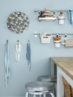 craft room by Sarah Richardson---kitchen tools can be great for organization; a magnetic spice rack for loose items, a modular bar for different storage.  located over work islands keep items close at hand and easy to reach for kids.  still, everything in its place, right? :)