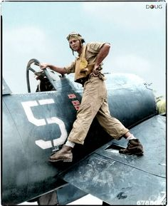 Lt (JG) Tom 'TK' Killefer of US Navy fighter squadron VF-17 (the original 'Jolly Rogers') standing on his Vought F4U-1A Corsair while waiting for an engine change on Nissan Island Airfield.