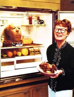 Alma Hitchcock with her husband Alfred's wax replica decapitated head in her freezer, 1970s (via lomography)