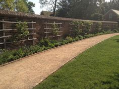 Rustic wood trellis, looks great alone or even better en masse, at Mount Vernon...via Brooke Giannetti.  Inspirtion for drawing attention away from ordinary, boring suburban wood fences!!!