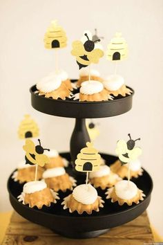 Take a look at this stunning bumble bee baby shower! The cupcakes are so cute! See more party ideas and share yours at CatchMyParty.com #catchmyparty #partyideas #bumblebee #bumblebeebabyshower