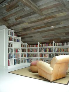 Interesting use of old gray barn wood as ceiling planks.  Makes this reading nook feel really cozy.