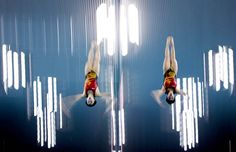 Chinese Divers Ruolin Chen and Hao Wang work in tandem during a synchronized swimming training session Wednesday at the Aquatics Centre in Olympic Park.