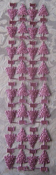Die cut and embossed pink foil paper Christmas trees from Germany for old fashioned card and ornament making