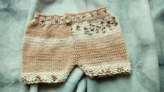 A very easy shorts pattern worked in 2 pieces to waistband. Button adds a accent point.